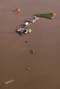 This aerial photo shows dredging equipment at work on White Rock Lake in 1998. The Dallas Morning News had published a series of stories in 1994 predicting that sediment would choke the lake if maintenance was not performed.
