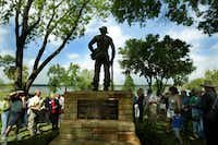 A statue honoring the Civilian Conservation Corps is unveiled at Sunset Bay in April 2004. The bronze statue honors workers who built buildings and structures around White Rock Lake as part of federal work programs during the Great Depression.