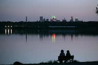 A couple enjoys the view on a quiet evening at White Rock Lake in 2008.