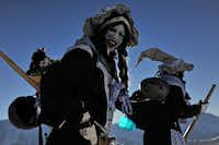 A participant looks on during the 30th edition of the Belalp Witches Ski Race on January 14, 2012 in Belalp, Switzerland. The race is inspired by a legend dating back to the middle ages, of a witch who tormented villagers in the area until she was burnt to death.