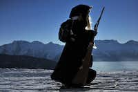 A participant looks on in the 30th edition of the Belalp Witches Ski Race on January 14, 2012 in Belalp, Switzerland.