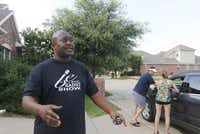 """""""This is not a racist neighborhood,"""" said Benét Embry, a radio personality who lives in the area and witnessed the incident. He commended the officers' speedy response.Michael Reaves  -  Staff Photographer"""