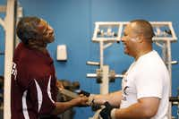 From L to R, fitness instructor Floyd Williams, of fitness ministry, talks with Rev. Craig Young, Director of Couples & Singles as Williams assists Young to be ready for a weight lifting at Oak Cliff Bible Fellowship Church.