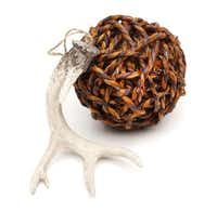 Organically inclined: Eco-friendly ornaments add an unpretentious air to a holiday tree. Twine ball, 7-inch diameter, $8 and naturally shed antler 6-inch long, $6, at Stanley Korshak, Dallas