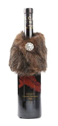 Dress up: Any bottle of wine will be elegant in a faux-fur collar with a crystal button closure. Available in a variety of styles. $12 at Panache at Home, Frisco.