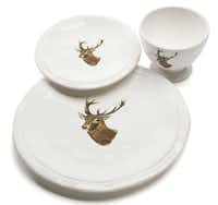 Reindeer run: Rustic dinnerware featuring a majestic reindeer brings the beauty of nature to a festive dinner table. Machine washable and microwavable. Dinner plate $28; salad plate $16; bowl/mug $13 at St. Michael's Woman's Exchange, Dallas