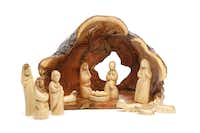 O Holy Night: Handcrafted of olive wood locally grown in orchards near Jerusalem and Bethlehem, this nativity illustrates the distinctiveness of nature. Each piece is meticulously hand-carved by artisans from unstained, light olive wood which features a dark grain. 13-piece set $380 at Neiman Marcus, The Shops at Willow Bend, Plano
