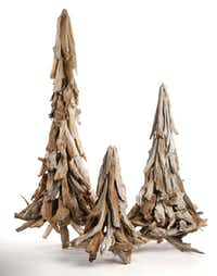 O Tannenbaum: Stylized Christmas trees are handmade from authentic barn wood. Each piece is individually selected and attached to create a festive silhouette. Beautiful on its own, it can be strung with lights or ornaments. Small, $75.00 21-inches high; medium, 135.00, 33-inches high; large, $165.00 46-inches high. All at Nicholson-Hardie Garden & Nursery, Dallas