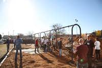 Mulch was spread across the playground at City Park Elementary during a service day for Flight, Vogel Alcove's Young Professionals Organization, on Jan. 20. The nonprofit was able to save several thousand dollars by having volunteers help with the mulching.(Photo by REN MORRISON)