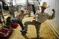 Superbull Junior team members Riggen Hughes and Garrett Gonzalez do the Gangnam Style dance in the back stalls while waiting to compete in Mesquite ProRodeo's youth bull riding.