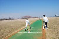 Ayush Todi (left) bowls to an adult batsman at a cricket match between the advanced members of United Youth Cricket Club and adult members of North Texas Cricket Association.( Staff photo by DANIEL HOUSTON  - neighborsgo)