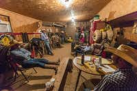 The utilitarian décor of the tack room lends itself to cowboy fellowship at the Waggoner Ranch. Conversation is low key, even when a story makes everybody laugh. There's time for a leisurely smoke and to swallow another cup of coffee. Though Jimbo Glover (Wagon Boss) hardly says a word, he rules the room. When he feels like it, he stands up and walks out into the horse pen. The workday's begun.