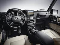 The hooded instrument panel on the 2013  G550 Mercedes-Benz houses black-faced gauges, and a 5-by-7-inch navigation screen protrudes from the shallow dash.Mercedes-Benz