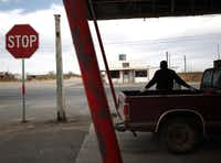 A man stops to get gas at Hopper Gas Station, the only business in Loving County.