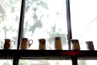 Vintage creamers  line a window ledge in the breakfast nook.