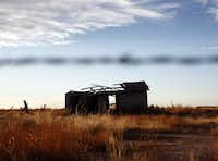 A rundown building sits in a field along Texas Highway 302 just west of Mentone in Loving County.