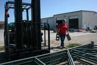 Susan Frank transports cinder blocks to help prop up frames at Hearts for Homes' warehouse in Denton.( Staff photo by DANIEL HOUSTON  -  neighborsgo )