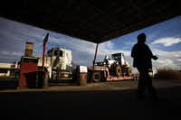 Oilfield worker Gerardo Mendoza enters the Hopper Gas Station in Mentone, Texas. Like many of the workers in Loving County, Mendoza lives outside the county in Odessa but drives in to work the oil fields in the county.
