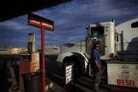 Oilfield worker Gerardo Mendoza pumps gas at Hopper Gas Station in Mentone, Texas.