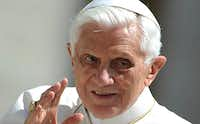 Pope Benedict XVI waves to worshipers as he arrives at St Peter's square for his weekly general audience at the Vatican last May. Pope Benedict XVI announced on February 11 that he would resign on Feb. 28 because his age prevented him from carrying out his duties, an unprecedented move in the modern history of the Catholic Church.(File 2012 - AFP/Getty Images)
