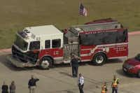 A Dallas Fire-Rescue truck carrying the casket of William Scott Tanksley leaves the Performing Arts Center in Terrell early Monday afternoon for a procession to Restland Memorial Park in Dallas. Tanksley, a 14-year D-FR veteran, died Feb. 10 when he fell from a freeway overpass while working an icy accident scene.(KXAS-TV - Image from video)