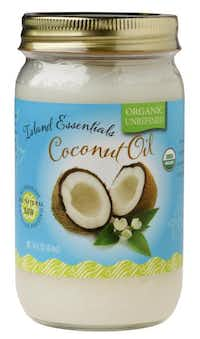 Coconut oil is solid at room temperature. Choose unrefined coconut oil for cooking.Evans Caglage - Staff Photographer