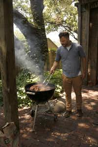 Chef Chad Houser works the grill.Evans Caglage - Staff Photographer