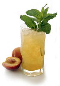 A Ginger Peach Julep is a twist on the traditional mint julep.Julia Ewan -  The Washington Post