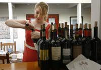 Courtney Keeling, sommelier and wine director of Del Frisco's Grille, opens bottles in preparation for the tasting.Evans Caglage  -  Staff Photographer