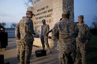 Military personnel wait for a news conference to begin Wednesday evening at Fort Hood after a gunman killed three people and wounded 16 others before killing himself. Scott & White Memorial Hospital in Temple said Thursday that three of the nine survivors brought there were in critical condition, the rest in serious condition. Fort Hood officials have not released details on the other seven survivors.Deborah Cannon - The Associated Press