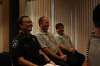 Highland Village Fire Chief John Glover (center) shares a laugh with Assistant Police Chief Mark Stewart (left) and Assistant Fire Chief Jason Collier before Tuesday's Highland Village council meeting.( Staff photo by DANIEL HOUSTON  -  neighborsgo )