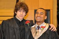 This undated photo shows Dzhokhar A. Tsarnaev (left) and a classmate after graduation from Cambridge Rindge and Latin High School. The unnamed friend is the nephew of Boston NPR personality Robin Young, who provided the photo to the Associated Press.Robin Young - via AP