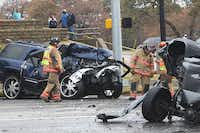 Emergency workers investigate the scene of a multicar accident and shooting on Dec. 14, 2011, at North Collins Street and Brown Boulelvard in Arlington. The driver of the blue SUV, Thomas Lester Harper, is on trial for the fatal shooting of a good Samaritan after the wreck and has been indicted in the death of the driver of the pickup seen at right.(File 2011 - Telegram)