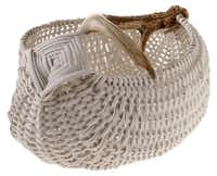 Handmade: A hand-woven basket from Michigander Cathryn Peters can hold decks of cards, napkins or serving utensils. $450, Grange Hall, Dallas.Evans Caglage  -  Staff Photographer