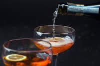 Prosecco is poured in to a gin and maple Aperol spritz( Ashley Landis  -  Staff Photographer )