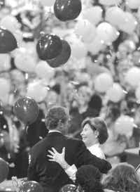 George W. Bush and wife Laura celebra- ted after he accepted the GOP nomina- tion in 2000. Life is more subdued now for the couple.