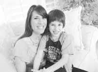 MariAnn Gattelaro of Plano, with her son Sam, worries that insurers will find loopholes in the health care law.