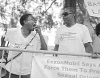 C.D. Kirven (left) and Michael Robinson were outside the Exxon Mobil shareholders meeting in downtown Dallas on Wednesday to protest the company's lack of a written policy barring discrimination against employees for sexual orientation or gender identity.