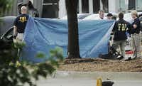 A tarp shields the view Monday morning of the car driven by two men killed Sunday in Garland after they opened fire outside a contest for cartoons depicting the Muslim prophet Muhammad. The car was dismantled to ensure that it was not carrying explosives.Ron Baselice - Staff Photographer