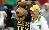 Ken Starr poses with the Baylor mascot. (2011 File Photo/Vernon Bryant)
