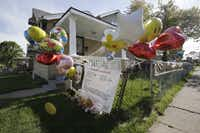 Balloons celebrating the rescue of Gina DeJesus fly from a fence outside her family's home Tuesday in Cleveland. DeJesus, Amanda Berry and Michelle Knight, who went missing separately about a decade ago, were found in and rescued Monday from a home just south of downtown Cleveland. Police arrested three brothers and said the women likely had been tied up during years of captivity.(Tony Dejak - AP)