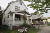 Crime scene tape marks a house in Cleveland where three women who had been missing for about a decade were rescued Monday. Amanda Berry, Gina DeJesus and Michelle Knight likely had been tied up during their years of captivity, said police, who arrested three brothers.Tony Dejak - The Associated Press
