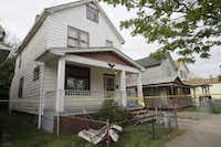 Crime scene tape marks a house in Cleveland where three women who had been missing for about a decade were rescued Monday. Amanda Berry, Gina DeJesus and Michelle Knight likely had been tied up during their years of captivity, said police, who arrested three brothers.(Tony Dejak - The Associated Press)