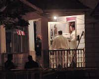 FBI agents remove evidence from the house near downtown Cleveland where three women who had disappeared as teenagers approximately ten years ago were found alive Monday. Amanda Berry, missing since 2003; Gina DeJesus, missing since 2004; and Michelle Knight, missing since 2002 were all found alive in the same house. Three suspects, all brothers, have been taken into custody.(Bill Pugliano - Getty Images)