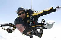 Former President George H.W. Bush announced via Twitter on Thursday that he intendes to make a tandem parachute jump near his summer home in Kennebunkport, Maine, to celebrate his 90th birthday. Bush had vowed to do so after skydiving (above) to celebrate his 85th birthday in 2009.(File 2009 - SSG Joe Abeln via AP)