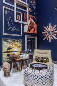 Pickard Design Studio Dark, dramatic walls, the de riguer starburst mirror and a sheepskin rug illustrate current trends.Lance Selgo  -  Unique Exposure Photography