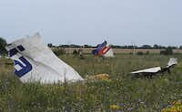 """Pieces of wreckage of the Malaysia Airlines flight MH17 litter a field Friday in Shaktarsk, Ukraine. Pro-Russia rebel leaders issued conflicting reports on whether """"black box"""" data recorders had been found from the plane, which US officials believe was brought down by a surface-to-air missile.Dominique Faget - AFP/Getty Images"""