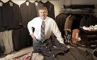 Bob Baumann shows off some of the items available at his Addison menswear store, Edward Baumann Clothiers(Matt Strasen)
