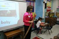 Pam Taylor gets her students' attention with a rain stick near the end of an instructional period at Garden Ridge Elementary. Taylor has taught at the school for 19 years of her 36-year teaching career.( Staff photo by DANIEL HOUSTON  -  neighborsgo )