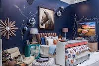 Pickard Design Studio Sarah Pickard used a moody navy in her bedroom vignette. Handpainted gold flourishes and rosettes that add luxury to a space layered with turquoise, orange, blues and browns.Lance Selgo  -  Unique Exposure Photography